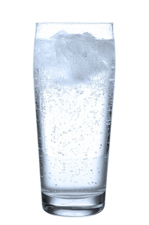 a glass filled with mineral water before white