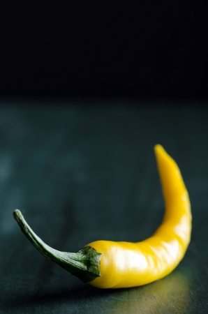 colourfully: a yellow chilli with copy space Stock Photo