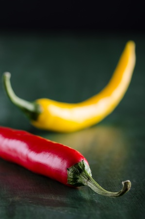 colourfully: a red and a yellow chilli Stock Photo