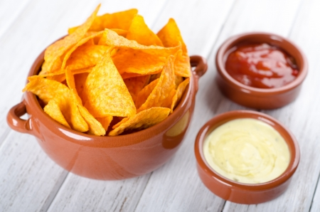 NACHO: Tortilla chips with two different dips on a white table Stock Photo