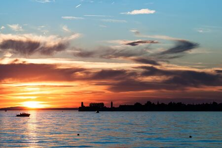friedrichshafen: Lindau at Lake Constance from a distance before sundown Stock Photo