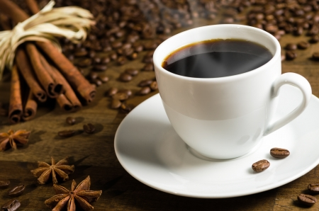 coffee bar: a cup of coffee with coffee beans and cinnamon sticks Stock Photo