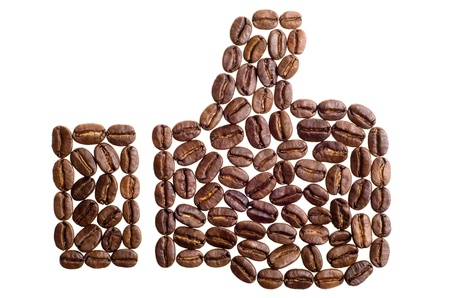 honouring: thumbs up symbol made of coffee beans on white background