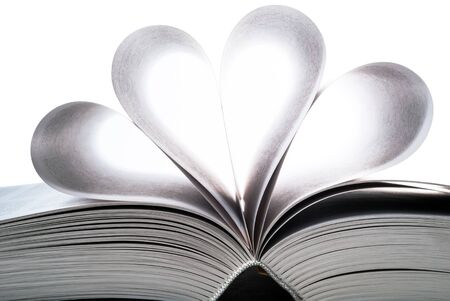 an opened book with single sides heart-shaped photo