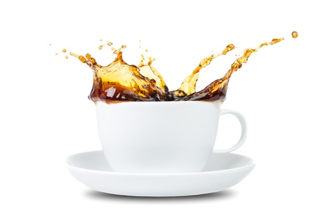 Coffee Splash in a coffee cup before white background photo