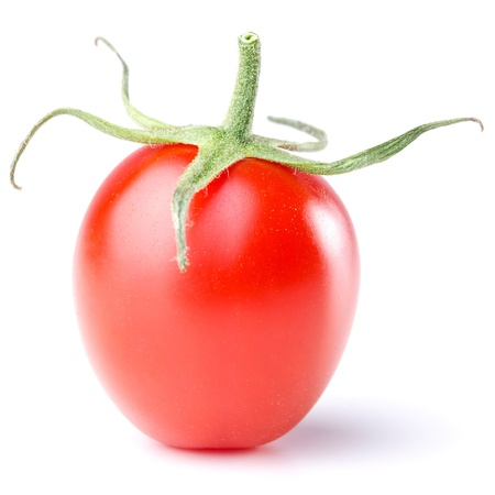 a tomato with green isolated before white background photo