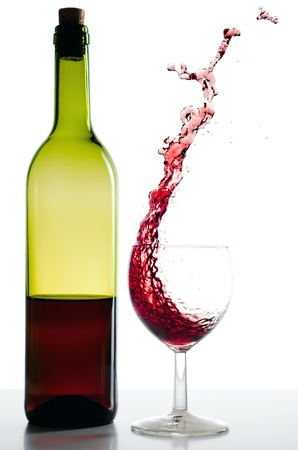 alcohol bottles: Red wine bottle and red wineglass Splash before white  Stock Photo