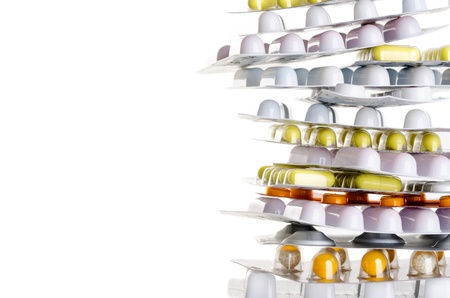 pharmaceutical drug: a pile of drugs before white background with copy space