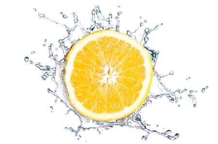 orange splash with water before white background photo