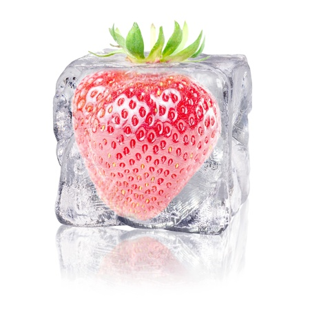 icily: a strawberry enclosed in an ice cube before white background Stock Photo