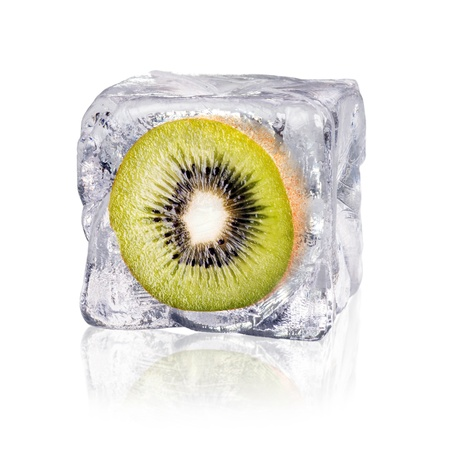 icily: a kiwi enclosed in an ice cube before white background