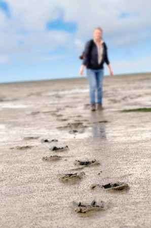 mud woman: footprints in the mudflats