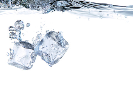 two ice cubes fall in the water before white background photo