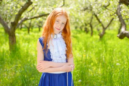 redhair: redhair girl in a sunny garden Stock Photo