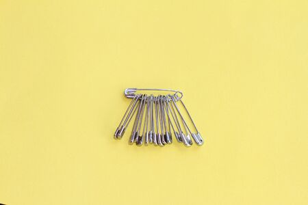 bunch or group of safety pins. Anti-hate and anti-racist symbol after the Brexit vote. Stock Photo