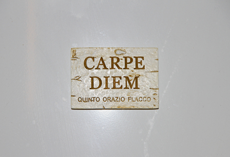 plaque with the Latin carpe diem the words of Horace meaning seize the day or make the most of the moment