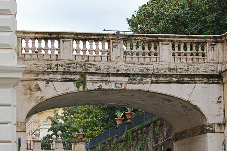 a bridge in Rome the Eternal City over Via Della Pilotta linking the Colonna Palace to the Quirinale gardens with a mosaic design 스톡 콘텐츠 - 117345670