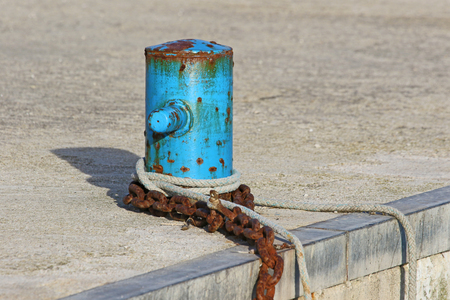 mooring post for fishing boats in the port in Numana Italy near Ancona on the Adriatic Riviera Stock Photo