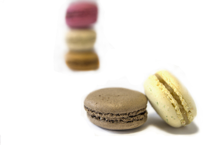 Multicolored macaroons, isolated, close up, brown, pink, white Stock Photo