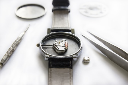 Replacing the battery in a wristwatch, watch repair Stock Photo