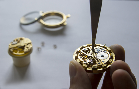 The watchmaker is repairing the mechanical watches in his workshop