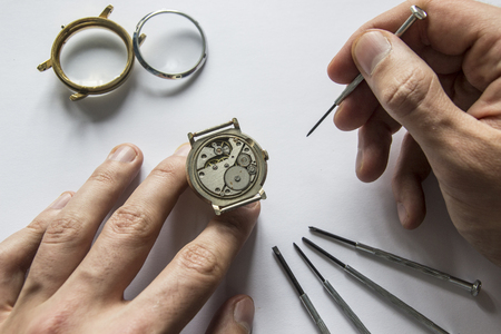 Watchmaker is repairing the mechanical watches in his workshop Stock Photo
