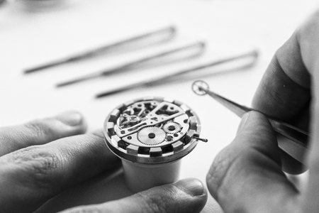 Watch maker is repairing a vintage automatic watch. Stock Photo