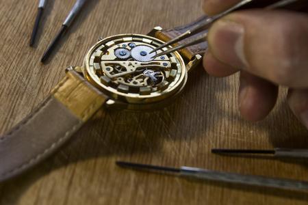 Watchmaker is repairing the mechanical watches in his workshop Stock fotó