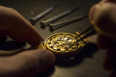 Clockmaker is repairing wrist watch. Close up
