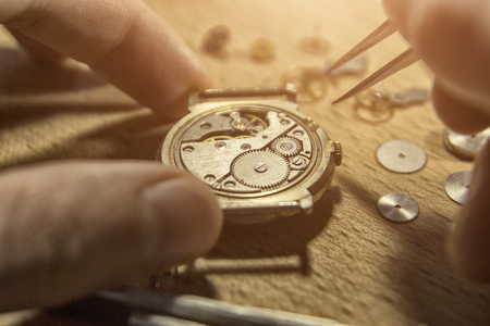 Watchmaker is repairing the mechanical watches in his workshop Stok Fotoğraf