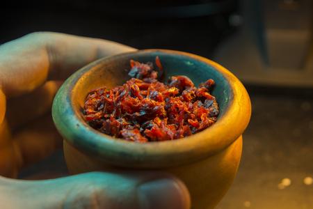 The process of cooking shisha, hookah bowl Stock Photo