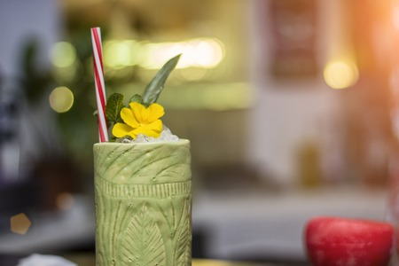 Cool tropical cocktail, the barman is working