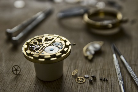Watchmakers workshop, watch repair, special tools for watch, background
