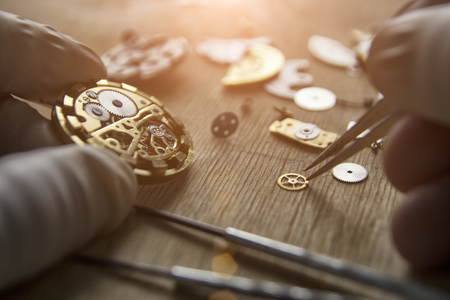 Process of installing a part on a mechanical watch, watch repair Stockfoto