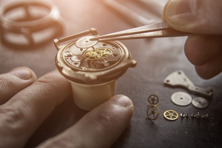 Process of installing a part on a mechanical watch, watch repair 写真素材