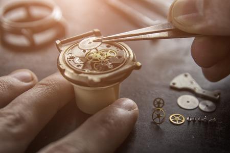 Process of installing a part on a mechanical watch, watch repair Foto de archivo