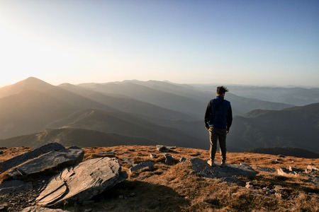 Man is feeling freedom in the top of the mountian Stock Photo