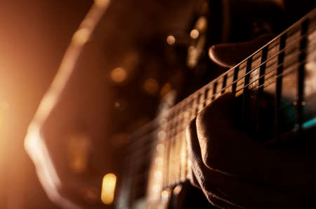 Rock concert, a musician is playing the guitar Stock Photo