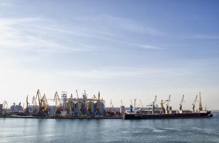 Cargo seaport, ships, a lot of cargo cranes
