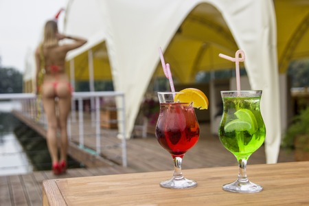 Nice coctails with a woman, red green colours