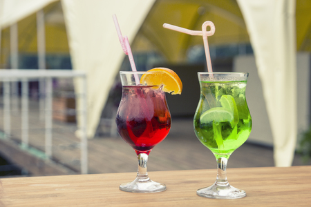Coloured coctails are on the tablte, close up 스톡 콘텐츠