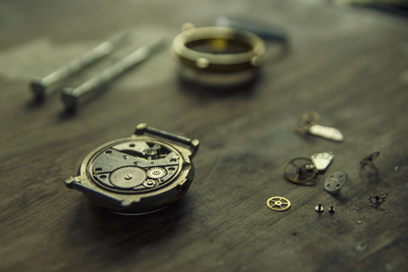 Process of installing a part on a mechanical watch, watch repair Фото со стока