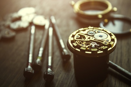 repairing the mechanical watches in his workshop