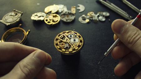 Mechanical watch repair, dismanted watch, close up Фото со стока