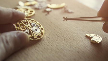 Watchmaker is repairing mechanical watches