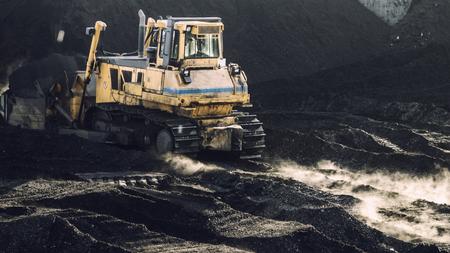 Excavator is working, dirty job, industrial, hard work Фото со стока
