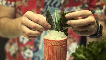 The barman is making tropical cocktails, close up
