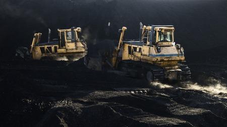 Two excavators are working, dirty job, mud Фото со стока