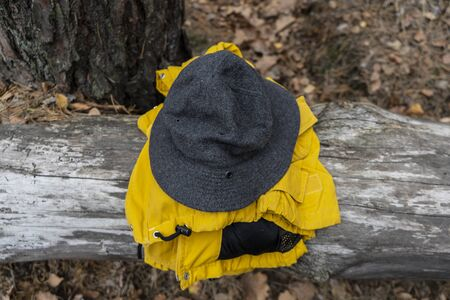 Autamn adventures, grey hat and yellow jacket Stock fotó