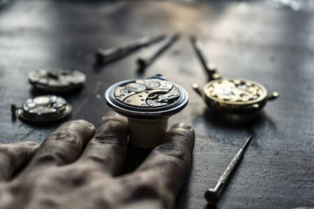 Mechanical watch repair, close up Фото со стока